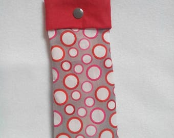 Sunglasses pouch is gray with white circles