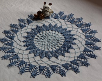 Doily hand crocheted cotton blue and backed.