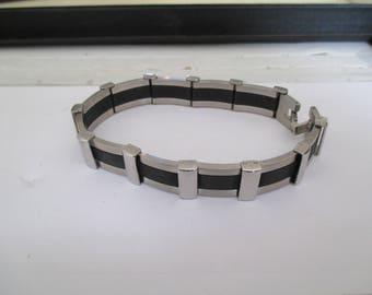 steel gray and black bracelet