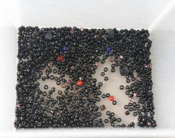 12g of black seed beads