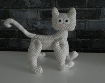 beige cat with white geographic pattern