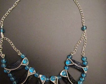 Necklace/ornament in blue glass beads and recycled aluminum caps