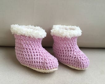 Light pink and white slippers for baby