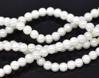 A set of 20 ivory glass pearl beads. Diameter of 4 mm.
