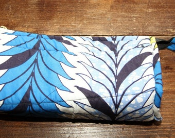 clutch in quilted black, blue and white wax