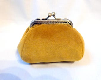 Mustard colored velvet coin purse.