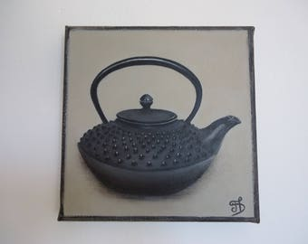 Painting canvas painting black teapot on a linen color background.