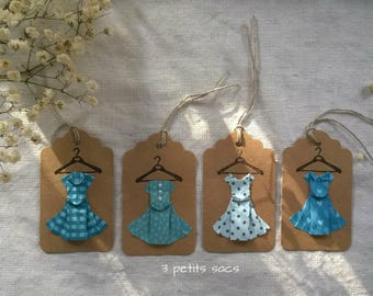4 labels kraft paper, folding origami, shades of blue green dresses