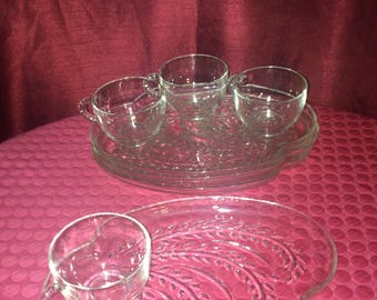 4 Clear Glass Serving Plates And 4 Tea Cups