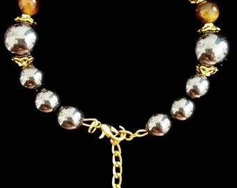 Bracelet with silver glass beads and Tiger eye beads