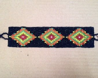 Cuff Bracelet with woven black, yellow, Orange and clasp with extender