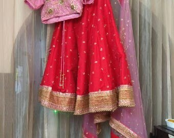 Bridal wear Raw silk Cancan lehenga, choli & net dupatta with heavy hand embroidery of zardozi and sequins, heavy laces and beads laces