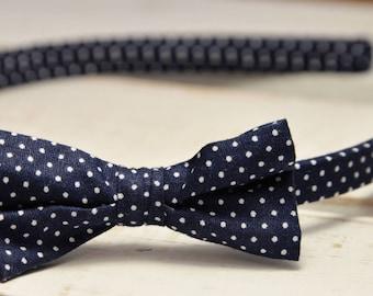 Navy blue bow headband with small white dots