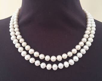 Double strand, white freshwater pearl necklace.