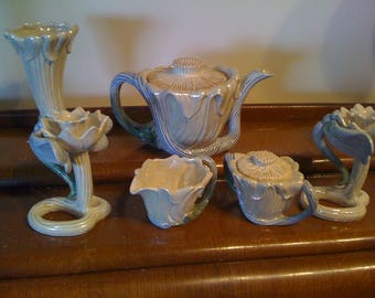Teapot with lid, creamer and sugar bowl, two candle stick holders and vase