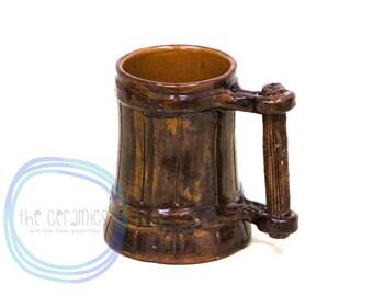 Handmade ceramic mug for beer a barrel form