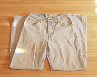 Vintage Levi's 560 / 33x34 / Loose Fit Tapered Leg / High Waisted / Distressed
