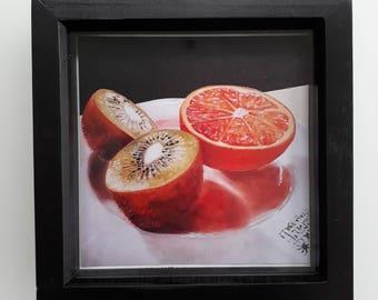 Kiwi and Orange Framed Print