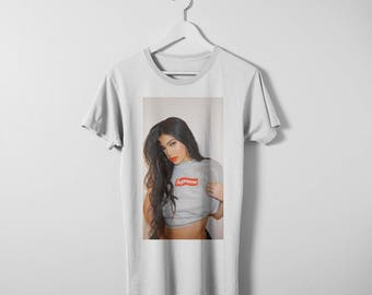 Kylie Jenner wearing Supreme T-shirt. Available in men's and women's sizes. Printed on a comfy cotton Bella Canvas shirt.