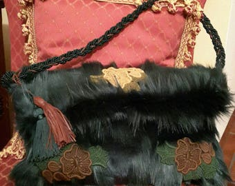 Pochette with shoulder strap that becomes bag