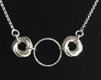 Mobius chainmaille necklace with a diamond cut ring on a belcher sterling silver chain