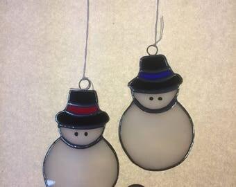 Little snowman in hat