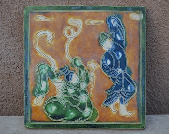 Chinese Tile with dancers. One standing dancer (blue) and one sitting.  Both in traditional robes Green, brown/gold and blue glazes