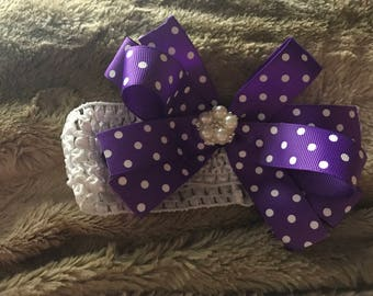 0-3 months headband with purple polka dot bow.