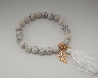 White beaded boho bracelet with tassel & leaf