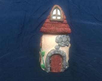 Thatched roof house jar