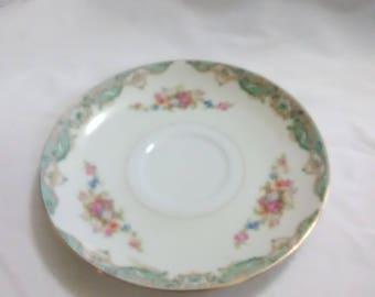 Vintage multicolored saucer