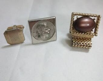 Vintage. Square, gold and a silver Indian cuff link.