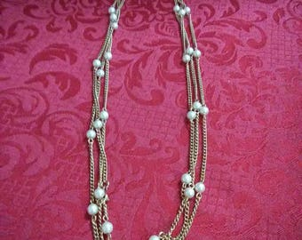 "Vintage faux pearl and gold tone necklace 30""."