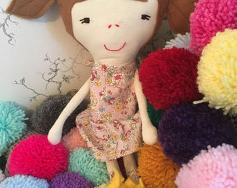 Handmade cute rag doll with pretty pink dress and yellow shoes