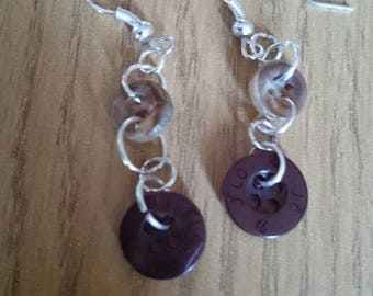 Dangling button earrings in natural tones