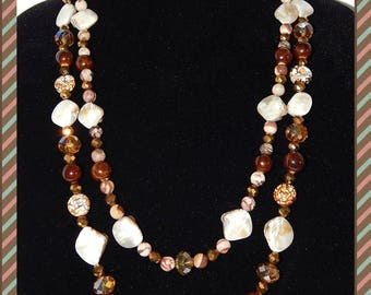Summer Sand - Lightweight double strand necklance.  Brown 10mm beads, beige shells; faceted clear  bronze 10mm stones