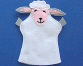 Light brown sheep puppet with book