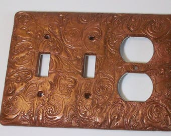 Curls and swirls metallic rust Double toggle and outlet combination light switch cover