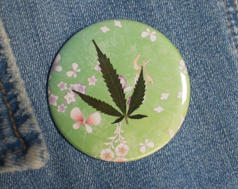 Pressed Cannabis Leaf Button on Green Background
