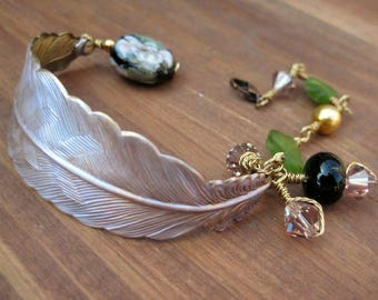 Color changing feather half cuff bracelet in lavender, golds, and greens