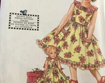 Simplicity 0665 Daisy Kingdom Childs Dress and Doll Dress Pattern, size 7-12, uncut