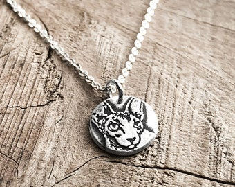 Tiny Sphynx cat necklace in silver