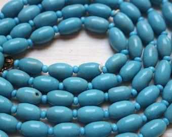 Vintage long blue glass necklace