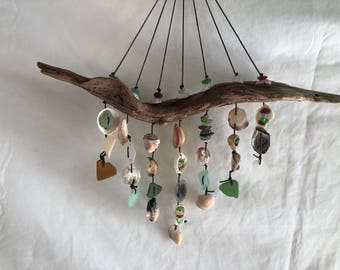 Sea glass and shell wall hanging