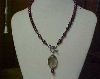 Handmade lariat style necklace with cranberry pearls and smokey qtz pendant