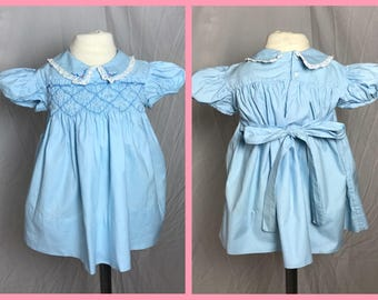 1960s Polly Flinders Baby Girl's Dress in Blue with Peter Pan Collar, Smocked Bodice, and Back Sash Tie - Size 12 Months