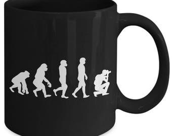 Evolution Of Man Photographer Coffee Mug