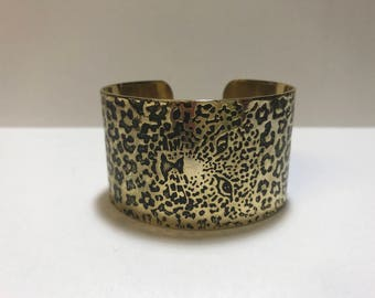 Amazing vintage 1980s leopard print cuff with camouflaged face