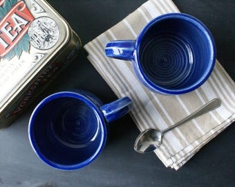 Two tankard style stoneware pottery tea mugs - hand thrown and glazed in ocean blue