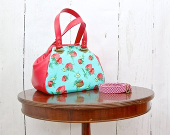 Small Carpet bag in Strawberries in Turquoise blue with Red Vinyl and optional cross body strap